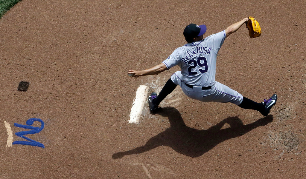 . Colorado Rockies starting pitcher Jorge De La Rosa throws during the third inning of a baseball game against the Milwaukee Brewers Sunday, June 29, 2014, in Milwaukee. (AP Photo/Morry Gash)