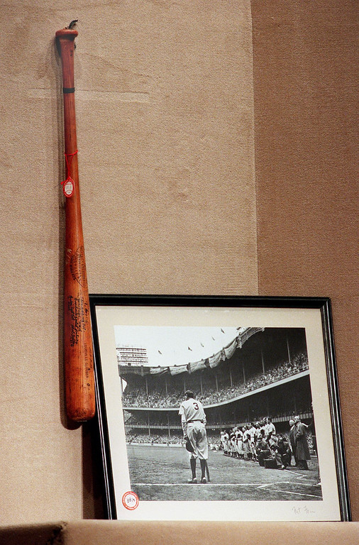 . NEW YORK, UNITED STATES:  A bat used by Babe Ruth as a cane in his final appearance at Yankee Stadium in 1948 (L) and a photo of Ruth and the bat (R) were auctioned 23 September, 1999, at Sotheby\'s in New York as part of the Barry Halper Collection of Baseball Memorabilia. The bat, photo and authenticating letters sold for 107,000 USD, including the commission. This was the first of seven days in which the Halper collection will be auctioned off.   (STAN HONDA/AFP/Getty Images)
