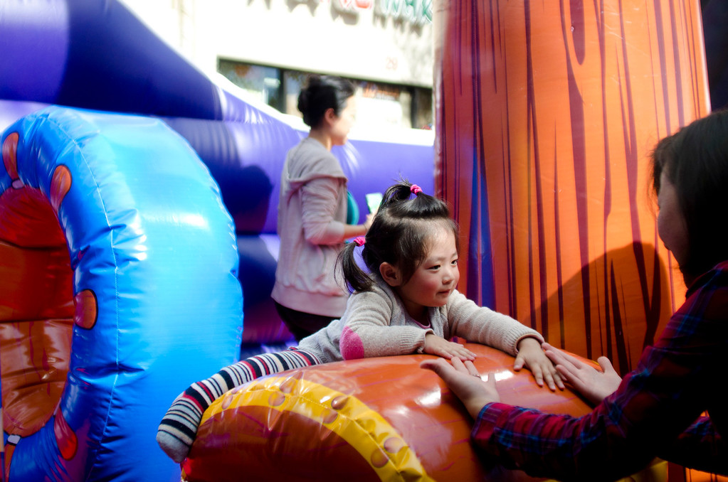 . Sara, 2, tries to jump onto higher ground while in a jumper at the 22nd Annual Alhambra Lunar New Year Celebration in Alhambra, Calif., Saturday, Feb. 16, 2013. The festival included food, rides, games and entertainment. (SGVN/Correspondent photo by Anibal Ortiz)