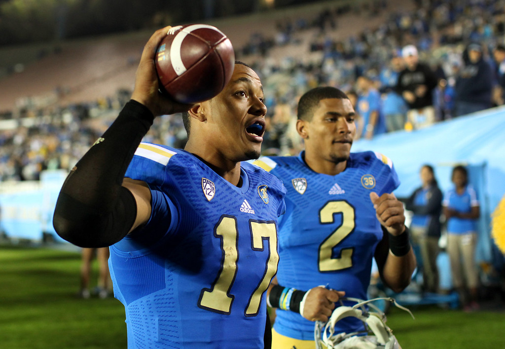 . UCLA QB Brett Hundley comes off the field after beating Colorado 45-23, Saturday, November 2, 2013, at the Rose Bowl. (Photo by Michael Owen Baker/L.A. Daily News)