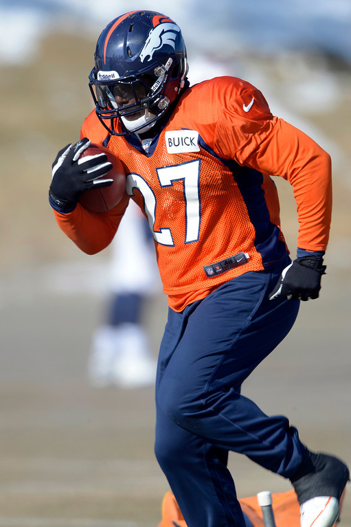 . Denver Broncos running back Knowshon Moreno (27) runs through drills during practice January 23, 2014 at Dove Valley.   (Photo by John Leyba/The Denver Post)