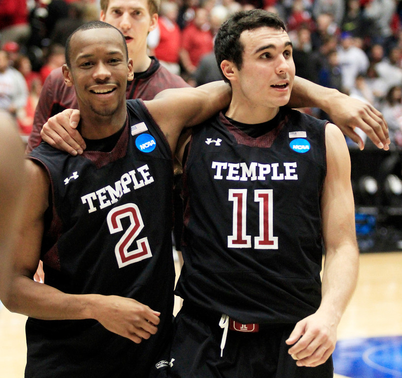 . CORRECTS BYLINE - Temple guard Will Cummings (2) and guard T.J. DiLeo (11) walk off court after they defeated North Carolina State 76-72 in a second-round game at the NCAA college basketball tournament, Friday, March 22, 2013, in Dayton, Ohio. (AP Photo/Skip Peterson)