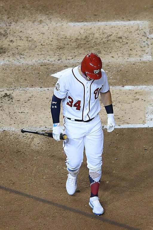 . Washington Nationals outfielder Bryce Harper (34) walks out of the batters box after striking out in the fourth inning at the Major League Baseball All-star Game, Tuesday, July 17, 2018 in Washington. (AP Photo/Nick Wass)