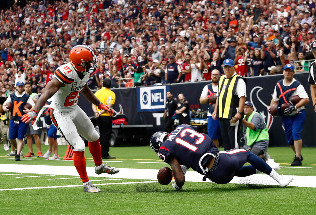 . Cleveland Browns cornerback Jamar Taylor (21) is unable to stop Houston Texans wide receiver Braxton Miller (13) from diving into the end zone for a touchdown in the first half of an NFL football game, Sunday, Oct. 15, 2017, in Houston. (AP Photo/Eric Gay)