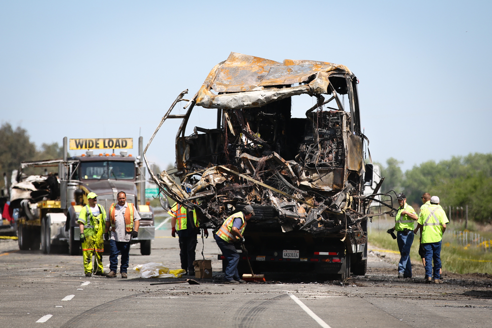 Description of . A bus involved in Thursday's deadly crash is loaded on to a truck at the scene on April 11, 2014  in Orland, California. Ten people were killed and dozens injured, including four still in critical condition, after a FedEx truck collided with a bus of high school students on Interstate 5 yesterday. The students were on their way to visit Humboldt State University in Northern California. (Photo by Elijah Nouvelage/Getty Images)