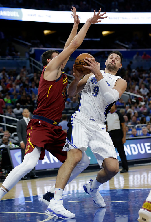 . Cleveland Cavaliers\' Ante Zizic, left, blocks the path of Orlando Magic\'s Nikola Vucevic (9) during the second half of an NBA preseason basketball game, Friday, Oct. 13, 2017, in Orlando, Fla. (AP Photo/John Raoux)