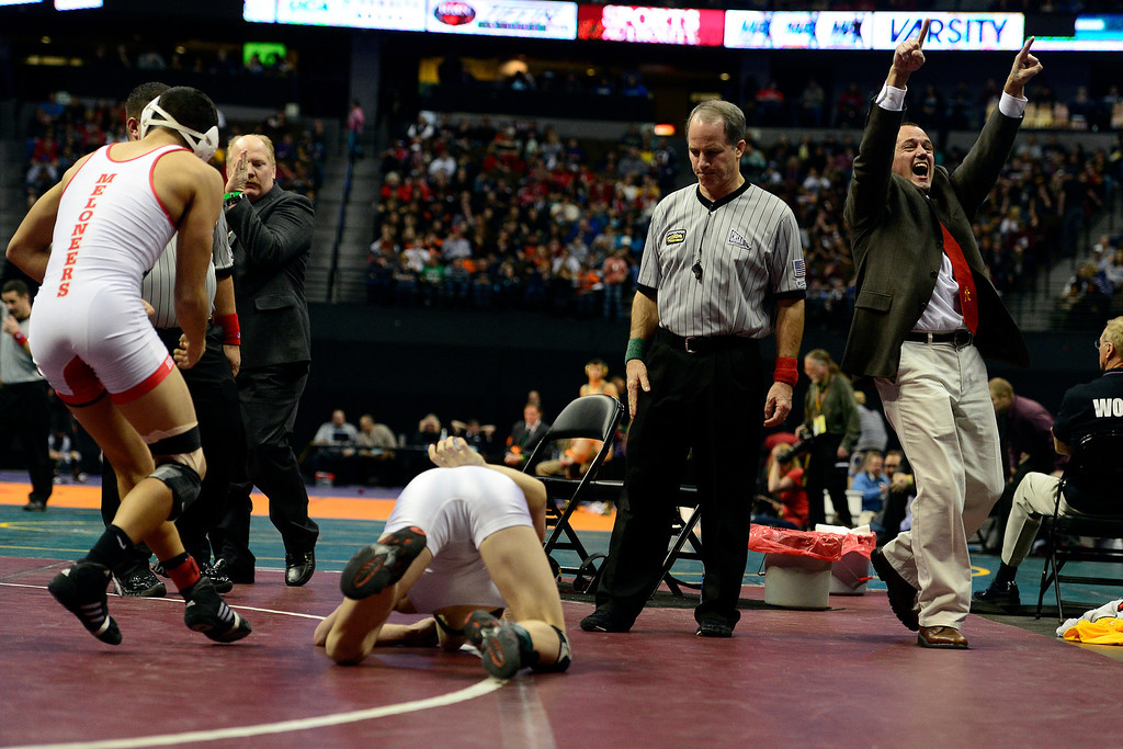 . DENVER, CO - FEBRUARY 23: Rocky Ford head coach Ron Nordin celebrates as 126-pounder Adam Baca defeats Paonia\'s Bo Pipher 5-2 in the class 2A final during the Colorado State High School Wrestling Championships. The state\'s top wrestlers squared off in four classes in front of a near-capacity crowd at the Pepsi Center. (Photo by AAron Ontiveroz/The Denver Post)