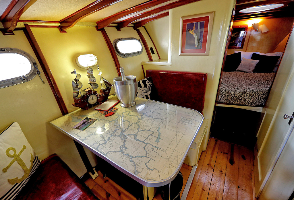. The galley of a 38-foot 1947 Chris Craft Yacht dry docked at the Shady Dell Trailer Court, is shown Tuesday, April 25, 2017, in Bisbee, Ariz. The yacht offers a v-shaped berthing area, at right, and sleeps two. After lying dormant for years, the Shady Dell reopened in 1996 with the intention of reviving its 1950\'s atmosphere of an authentic trailer court and became a unique travel destination of it\'s own. (AP Photo/Matt York)