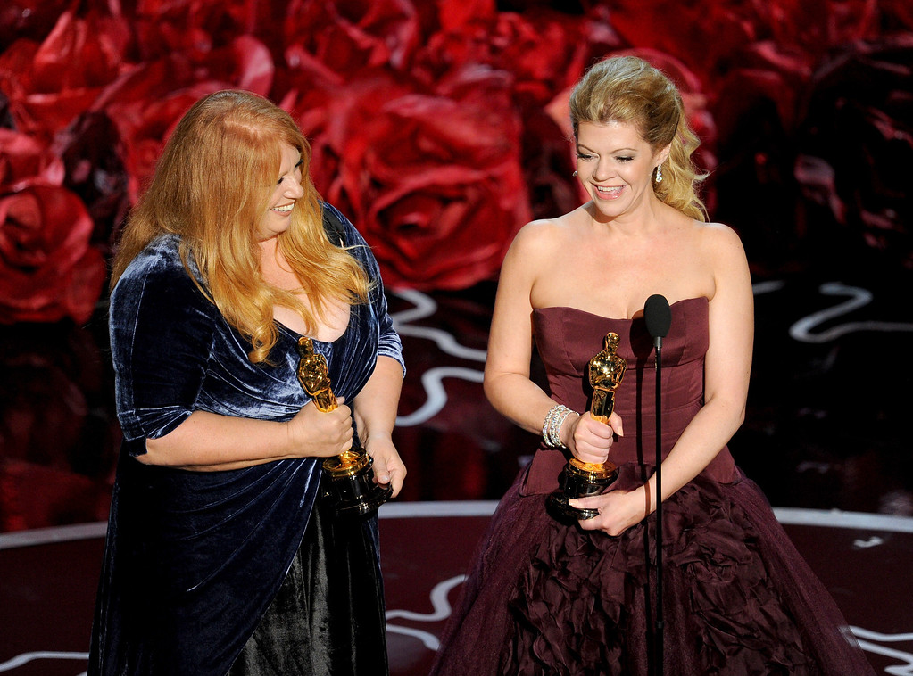. Adruitha Lee (L) and Robin Mathews accept the Best Achievement in Makeup and Hairstyling award for \'Dallas Buyers Club\' onstage during the Oscars at the Dolby Theatre on March 2, 2014 in Hollywood, California.  (Photo by Kevin Winter/Getty Images)