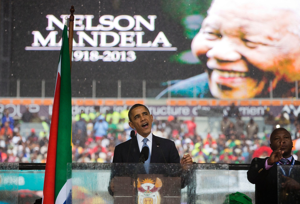 . President Barack Obama speaks to crowds attending the memorial service for former South African president Nelson Mandela at the FNB Stadium in Soweto near Johannesburg, Tuesday, Dec. 10, 2013. World leaders, celebrities, and citizens from all walks of life gathered on Tuesday to pay respects during a memorial service for the former South African president and anti-apartheid icon. (AP Photo/Evan Vucci)