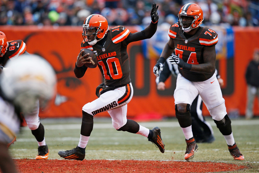. Cleveland Browns quarterback Robert Griffin III (10) scrabbles for a first down in the first half of an NFL football game against the San Diego Chargers, Saturday, Dec. 24, 2016, in Cleveland. (AP Photo/Ron Schwane)