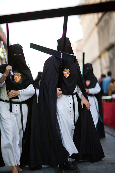Hooded penitents bearing wooden crosses, Holy Week 2008, Seville, Spain