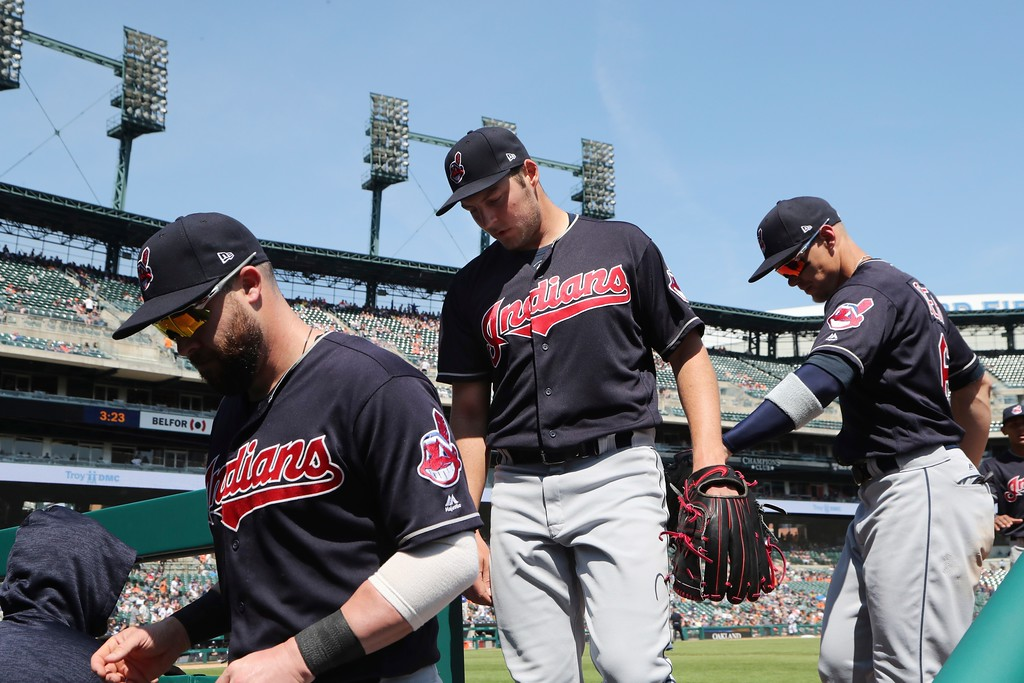 . Cleveland Indians starting pitcher Trevor Bauer, center, walks to the dugout after completing the eighth inning of a baseball game against the Detroit Tigers, Wednesday, May 16, 2018, in Detroit. (AP Photo/Carlos Osorio)