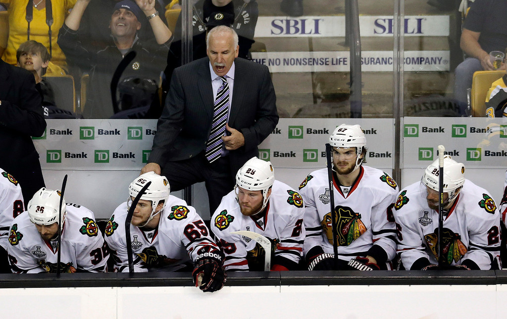 . Chicago Blackhawks head coach Joel Quenneville shouts instructions to his team during the third period in Game 3 of the NHL hockey Stanley Cup Finals against the Boston Bruins in Boston, Monday, June 17, 2013. (AP Photo/Charles Krupa)