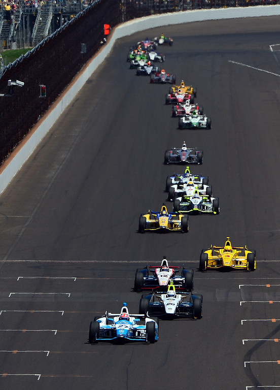 . James Hinchcliffe, driver of the #27 Andretti Autosport Honda Dallara, leads the field during the 98th running of the Indianapolis 500 at Indianapolis Motorspeedway on May 25, 2014 in Indianapolis, Indiana.  (Photo by Robert Laberge/Getty Images)