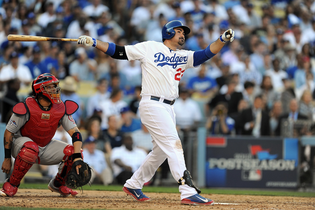 . The Dodgers\' Adrian Gonzalez watches his solo homer head for the wall in the 8th during game 5 of the NLCS against the Cardinals at Dodger Stadium Wednesday, October 16, 2013. The Dodgers beat the Cardinals 6-4. (Photo by Hans Gutknecht/Los Angeles Daily News)