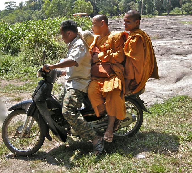 Monks on moped