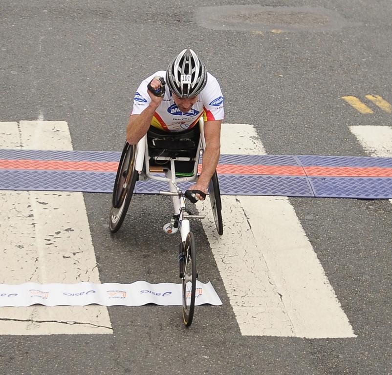 . USA Kirige Schabort the first wheel chair to cross the finish line during the 2013 LA Marathon. Santa Monica CA. March 17,2013. Photo by Gene Blevins/ LA dailynews.