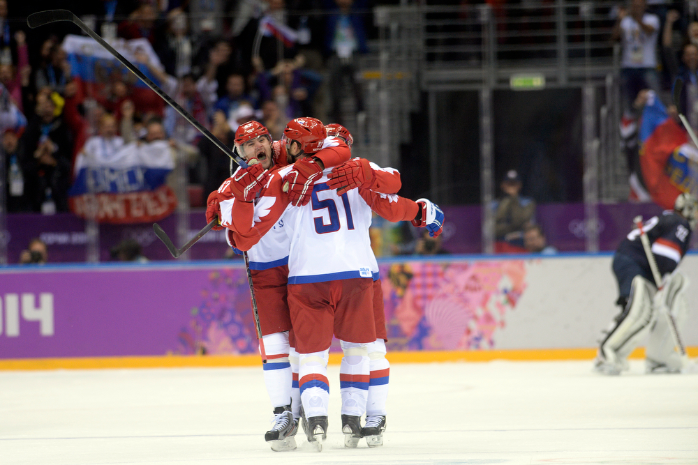 . Team Russia celebrates a goal that would ultimately be reversed by Fyodor Tyutin (51) against the U.S.A. during  the third period of the U.S.A.\'s shootout-win at Bolshoy arena. The goal in question would\'ve made the score 3-2 with just minutes to play. Sochi 2014 Winter Olympics on Saturday, February 15, 2014. (Photo by AAron Ontiveroz/The Denver Post)