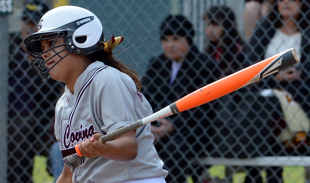 . West Covina\'s Alex Rodriguez watches her RBI double in the first inning of a prep softball game against at Los Flores Park in La Verne, Calif., on Thursday, March 27, 2014. Bonita won 6-3. (Keith Birmingham Pasadena Star-News)