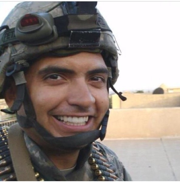 "Miguel Angel Baez III, U.S. Army. Spouse of Elena Baez. Elena says, ""He is my hero, and I am so honored and proud ot be a part of the military as a spouse supporting her husband."""