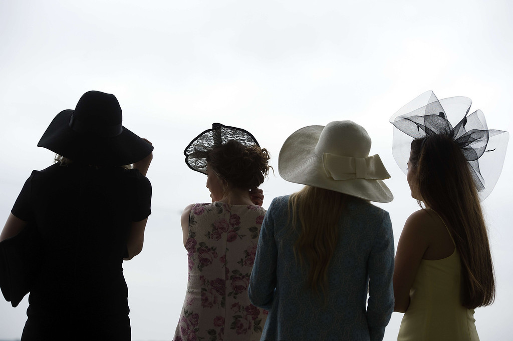 . Race-goers attend Ladies Day at the annual Royal Ascot horse racing event near Windsor, Berkshire on June 19, 2014. AFP PHOTO / CARL COURT/AFP/Getty Images