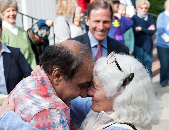 10/16/18 Wesley Bunnell | Staff Malik Naveed Vin Rehman hugs Nan Meneely outside of First Congregational Church of Old Lyme on Tuesday afternoon after a press conference to announce he will return home to New Britain along with Zahida Altaf while awaiting their deportation case which is pending before the 2nd Circuit Court of Appeals. The couple had taken sanctuary at the church in March after being ordered by Customs Enforcement (ICE) to leave the United States by March 19th.