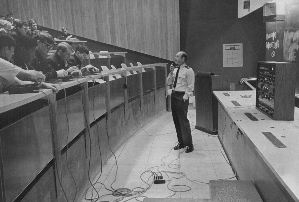 """. Captain Bill Nolls lectures his class on future energy development and use. He\'s an academy chemistry instructor and one of the developers of the \""""doomsday machine.\"""" 1977.  The Denver Post Library Archive"""
