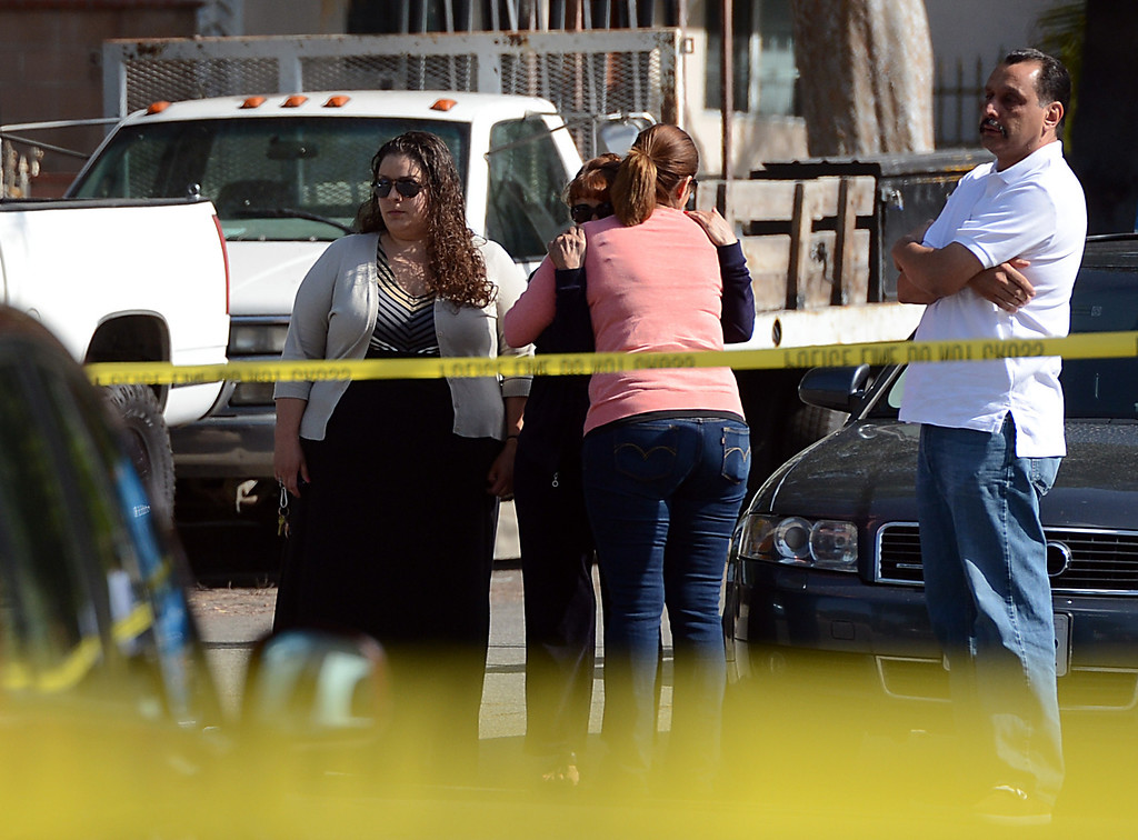 . Family and friends gather at the scene as Pomona Police investigate the scene of a murder-suicide in the 2100 block of north Ramsey Way in Pomona, CA, Friday, May 9, 2014. (Jennifer Cappuccio Maher/Inland Valley Daily Bulletin)