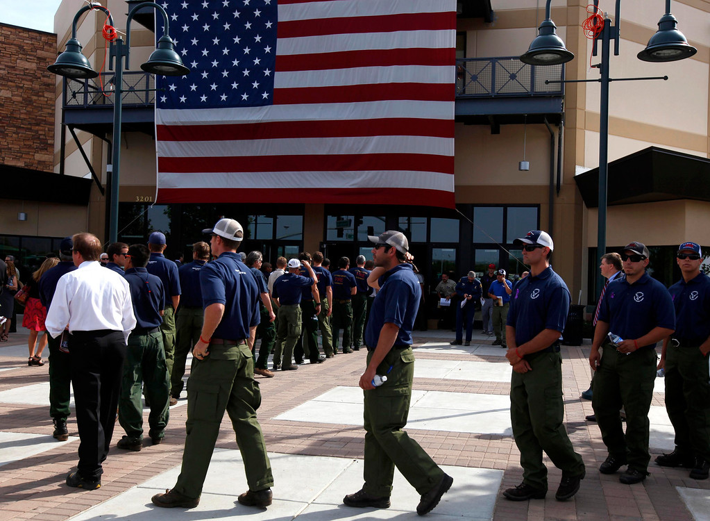 . Firefighters arrive at a memorial for the Prescott Fire Department\'s Granite Mountain Hotshots team in Prescott Valley, Arizona July 9, 2013.  REUTERS/Mike Blake