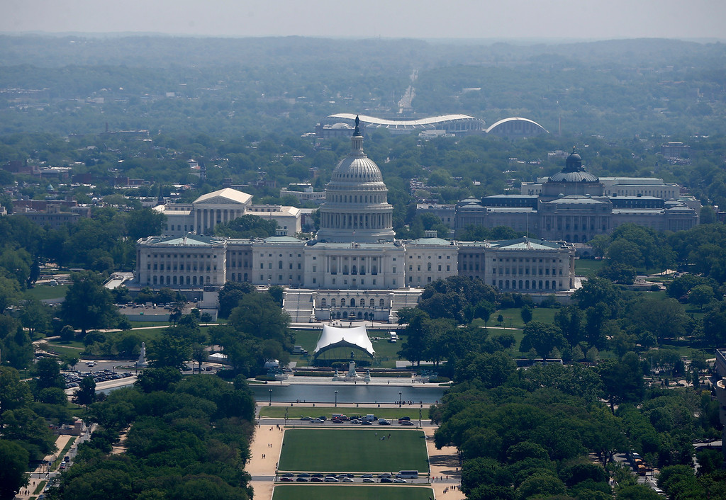 . RFK Memorial Stadium is visible behind the U.S. Capitol from the 500-foot level of the Washington Monument in Washington, Monday, May 12, 2014, as it re-opens.  (AP Photo)
