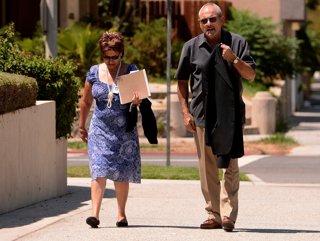 . San Bernardino councilwoman Virginia Marquez and City Manager Allen Parker arrive to the United States Bankruptcy court in Riverside August 28,2013.  A tentative ruling by a Federal judge grants San Bernardino bankrupty protection.  GABRIEL LUIS ACOSTA/STAFF PHOTOGRAPHER.