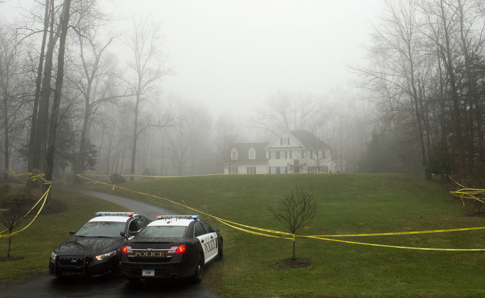Description of . Police are positioned outside the home of Nancy Lanza  December 18, 2012 in Newtown, Connecticut.  Nancy Lanza was killed by her son Adam before going on his rampage at Sandy Hook Elementary School on December 14, 2012. AFP PHOTO/DON  EMMERT/AFP/Getty Images