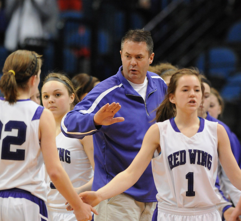 . Red Wing Wingers head coach Dave Muelken and guard McKayla Muelken (1) cheer on guard McKenna Schaffer (22) as she comes off the court in the second half. (Pioneer Press: John Autey)