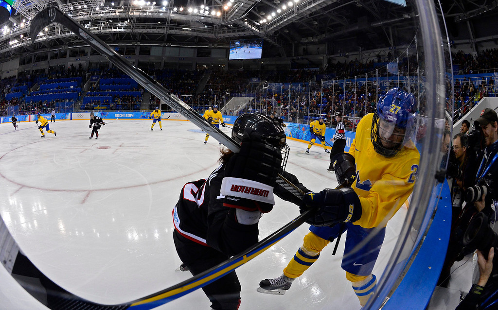 . Emma Nordin (R) of Sweden fights for the puck with Miho Shishiuchi (L) of Japan in the second period during the match between Sweden and Japan at the Shayba Arena in the Ice Hockey tournament at the Sochi 2014 Olympic Games, Sochi, Russia, 09 February 2014  EPA/LARRY W. SMITH