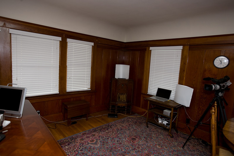 Heavy red velvet drapes will be across these windows for sound and light control.
