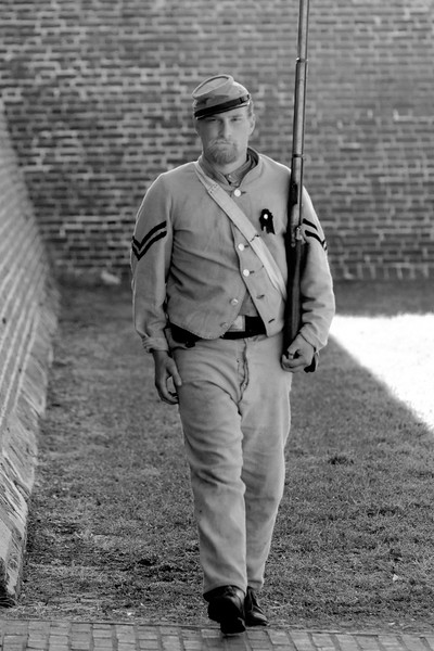 Reenactor Private Tyler Dean, a member of the Palmetto Rifle Company, patrols the entrance to Ft. Moultrie in Sullivan's Island, South Carolina on Monday, April 11, 2011. ..The 150th Anniversary of the Firing on Ft. Sumter was commemorated with lectures, performances, demonstrations, and a living history throughout the area on James Island, Charleston, Mt. Pleasant, and Sullivan's Island during the week from April 8-14, 2011. Photo Copyright 2011 Jason Barnette