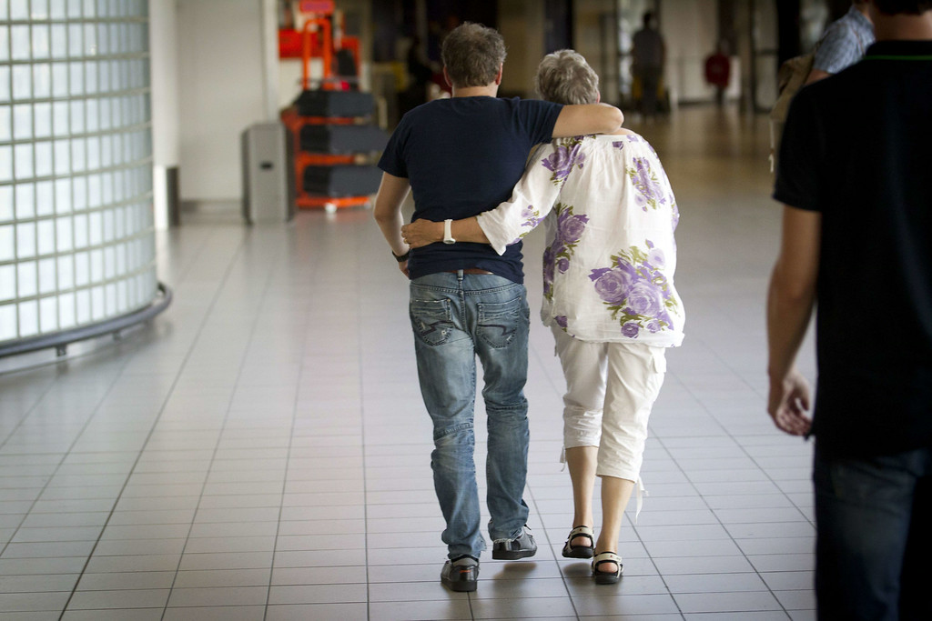 . A couple walks to the location where more information will be given regarding the Malaysia Airlines plane traveling from Amsterdam to Kuala Lumpur that crashed near the town of Shaktarsk, in rebel-held east Ukraine, at Schiphol Airport near Amsterdam, the Netherlands on July 17, 2014. Malaysia Airlines said on July 17 that a passenger plane which crashed in eastern Ukraine was carrying 295 people, amid speculation it had been shot down.  AFP PHOTO / ANP / JEROEN JUMELET /AFP/Getty Images