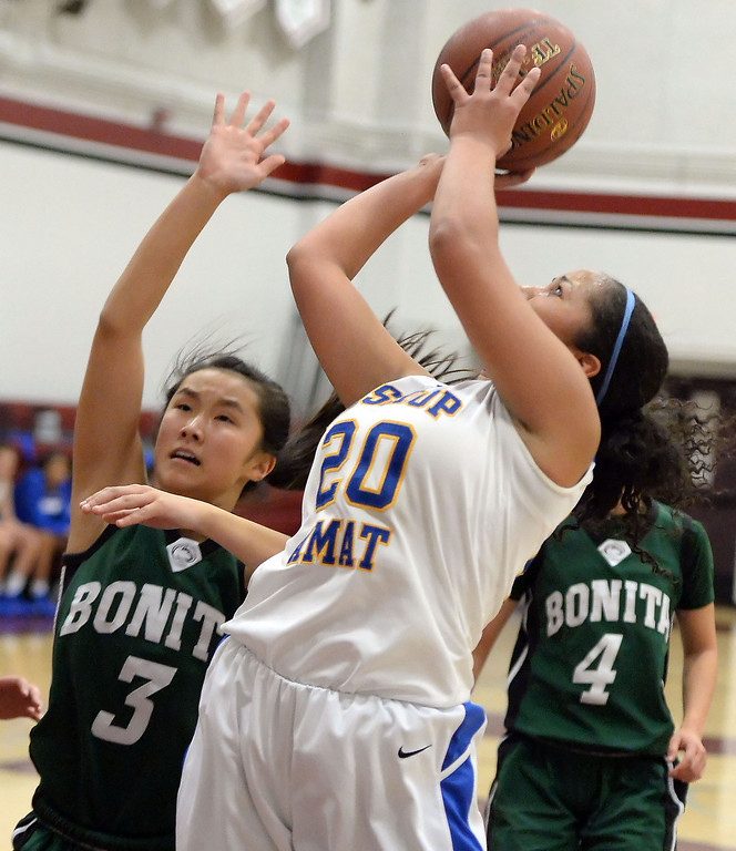 . Bishop Amat\'s Janae Chamois (20) shoots past Bonita\'s Cassie Martinez (3) in the first half of the Covina basketball tournament at Covina High School in Covina, Calif., on Saturday, Dec. 14, 2013. Bonita won 49-41.   (Keith Birmingham Pasadena Star-News)