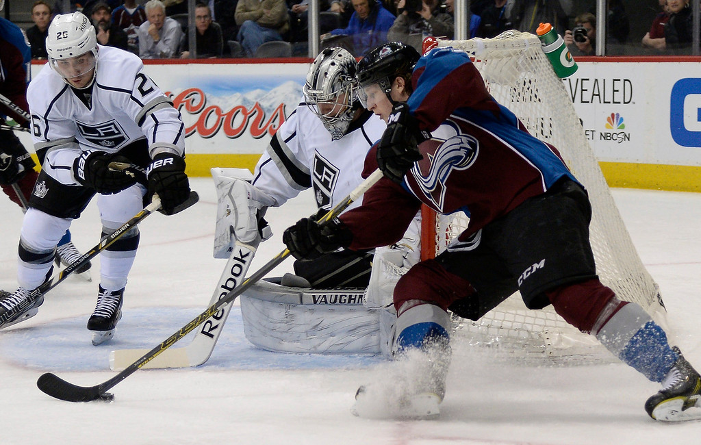 . DENVER, CO - FEBRUARY 27: Colorado Avalanche center Nathan MacKinnon (29) attempts a backhand shot on Los Angeles Kings goalie Martin Jones (31) during the third period February 27, 2014 at Pepsi Center. The shot went wide asLos Angeles Kings defenseman Slava Voynov (26) defends on the play.  (Photo by John Leyba/The Denver Post)