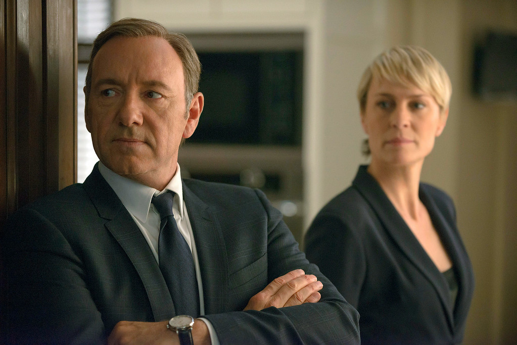 """. This image released by Netflix shows Kevin Spacey as Francis Underwood, left, and Robin Wright as Clair Underwood in a scene from \""""House of Cards.\"""" Spacey was nominated for an Emmy Award for best actor in a drama series on Thursday, July 10, 2014, for his role as Frank Underwood. The 66th Primetime Emmy Awards will be presented Aug. 25 at the Nokia Theatre in Los Angeles. (AP Photo/Netflix, Nathaniel E. Bell)"""