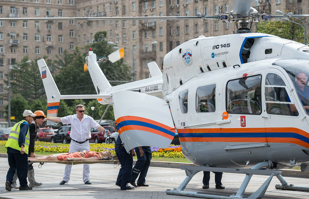 . Rescuers and paramedics use helicopters to evacuate passengers injured as several subway cars derailed in Moscow, on July 15, 2014. AFP PHOTO / DMITRY SEREBRYAKOV/AFP/Getty Images
