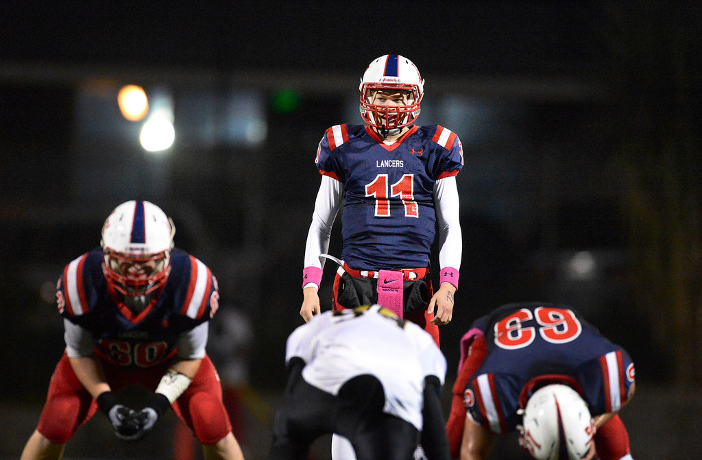 . La Salle\'s quarterback Will Plyburn gets ready to start a down as they play Bishop Montgomery during Friday night\'s football game at La Salle High School in Pasadena, October 25, 2013.  (Photo by Sarah Reingewirtz/Pasadena Star-News)