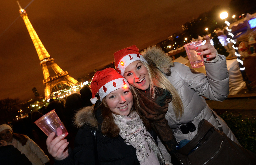 . People celebrate the New Year on the Trocadero Square before the Eiffel Tower in Paris on December 31, 2013. PIERRE ANDRIEU/AFP/Getty Images