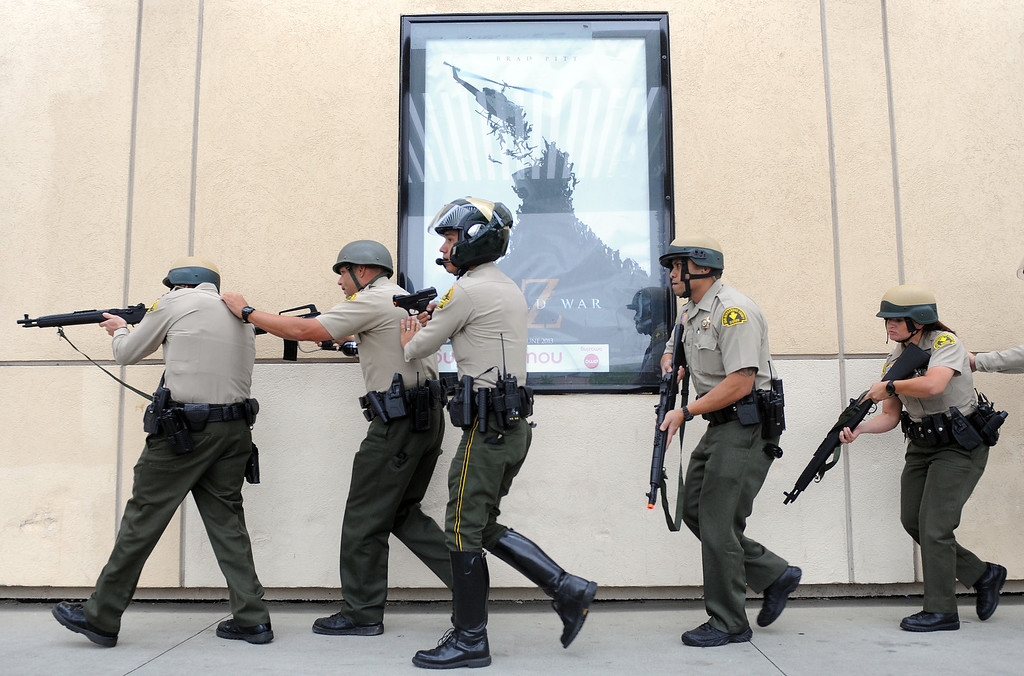 . (Will Lester/Inland Valley Daily Bulletin) Rancho Cucamonga Sheriff deputies approach the theaters side entrance during a mock theater shooting training drill Thursday morning August 1, 2013 at Victoria Gardens in Rancho Cucamonga.
