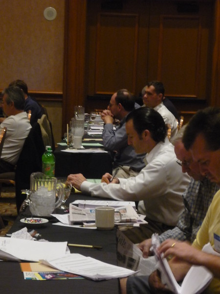 Members listen to Mr. Alito's presentation