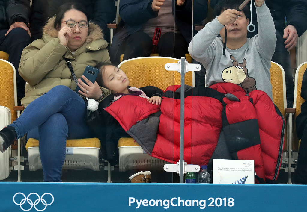 . A girl sleeps during the men\'s curling match at the 2018 Winter Olympics in Gangneung, South Korea, Sunday, Feb. 18, 2018. (AP Photo/Aaron Favila)
