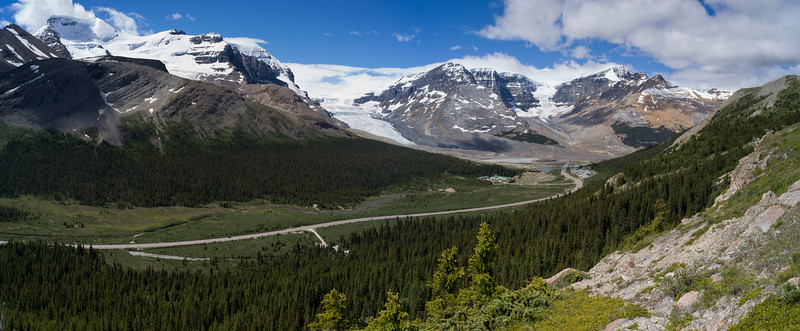 Road passing through mountainous landscape with glacier in the background, Columbia Icefields, Icefields Parkway, Jasper, Alberta, Canada