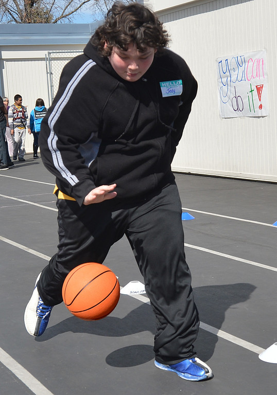 . Jedy, 13, of Park Middle School in Antioch, runs while he dribbles the basketball during a Special Olympics basketball skills event at Turner Elementary School in Antioch, Calif., on Friday March 8, 2013.  (Dan Rosenstrauch/Staff)