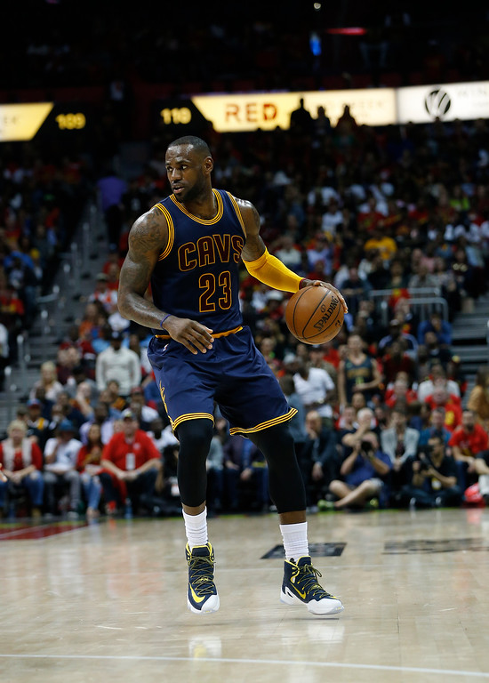 . Cleveland Cavaliers forward LeBron James (23) drives the ball against the Atlanta Hawks in the second half of Game 3 of the second-round NBA basketball playoff series, Friday, May 6, 2016, in Atlanta. (AP Photo/John Bazemore)
